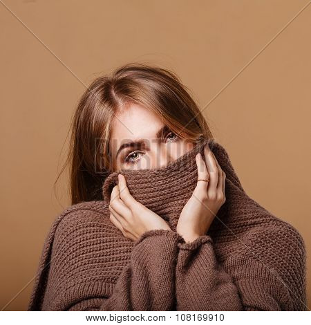 Girl Wrapped In A Warm Sweater. Girl Is Sick.