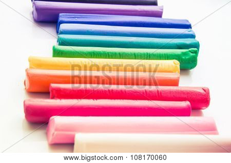 Rainbow Colors Plasticine Play Dough Modeling Clay Isolated Over White.