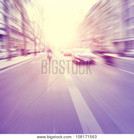 Motion blurred image of city traffic. Vintage style.