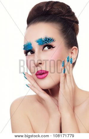 Young beautiful woman with fancy feather eyebrows, dot manicure, ombre lips and stylish hair bun over white background, copy space