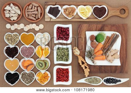 Superfood and herb selection for cold and flu remedy including foods high in antioxidants and vitamin c.