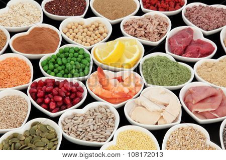 Health and body building high protein super food of meat, fish, with supplement powders, seeds, cereals, grains, fruit and vegetables. Selective focus.