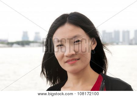 Chinese Woman With City Backdrop