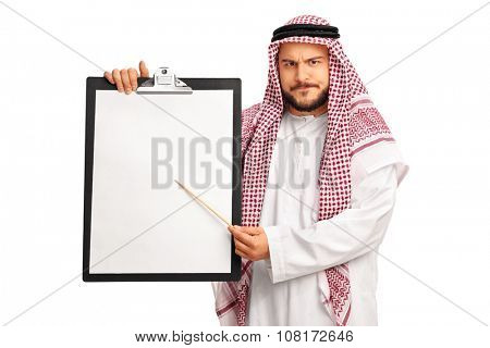 Young grumpy Arab holding a clipboard and pointing on it with a wooden stick isolated on white background