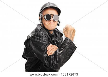 Cocky senior motorcyclist gesturing with his hand with gripped fist isolated on white background