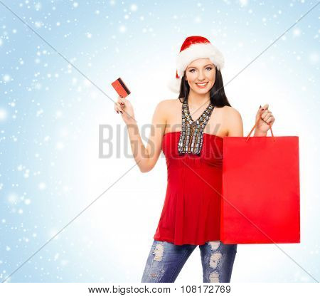 Young and beautiful Christmas shopper girl with the electronic cigarette over winter background with snowflakes