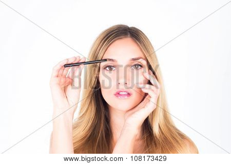 Woman paints her eyebrows. make up