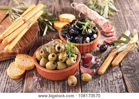 olive, salami and breadstick