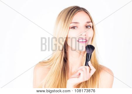 Happy smiling with teeth woman holding brush for rouge.