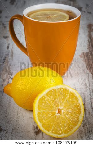 Fresh Lemon And Cup Of Hot Tea On Wooden Table, Healthy Nutrition