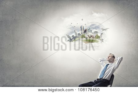 Businessman in chair and blank thought cloud above his head