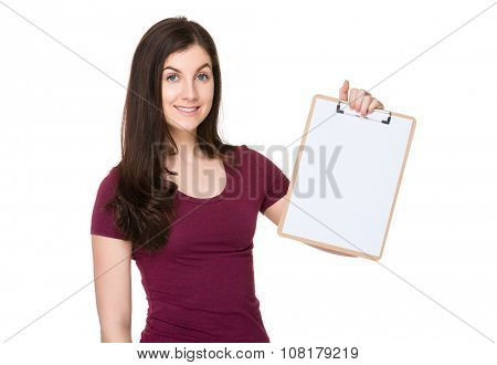Caucasian woman showing the blank page of clipboard