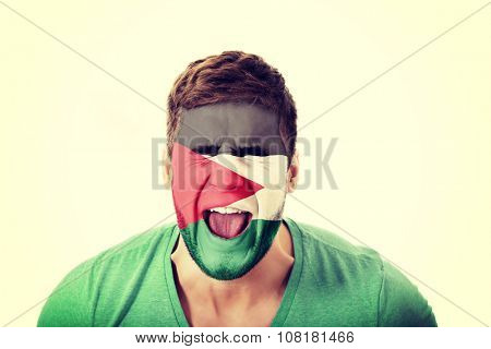 Screaming man with Palestine flag painted on face.