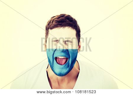 Screaming man with San Marino flag painted on face.