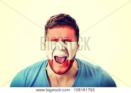 Screaming man with Austria flag painted on face.