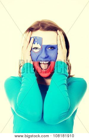 Woman with Slovenia flag painted on face.