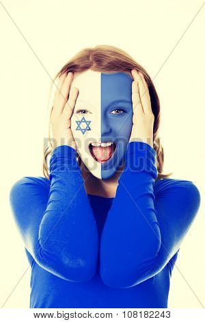 Woman with Israel flag painted on face.
