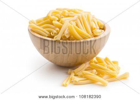 uncooked pasta caserecce  in bowl on white background