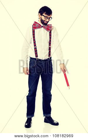 Funny man wearing suspenders pointing down with big pencil.
