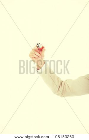 Businesswoman's hand with oversized pen.