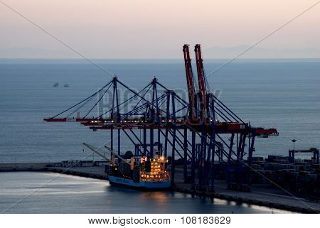 Cranes in Malaga Port at dusk.