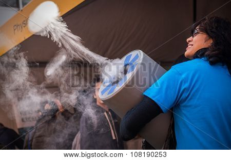 Lady making smoke puff