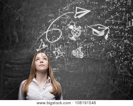 A Beautiful Lady Is Dreaming About Graduation. Math Formulas, An Arrow, Geometric Figures Are Drawn