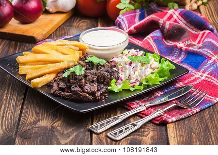 Kebab Of Beef With French Fries And Salad