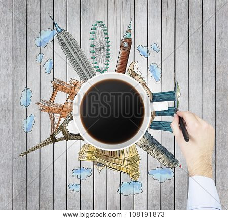 Top View Of A Coffee Cup And The Hand Draws Colourful Sketches Of The Most Famous Cities In The Worl