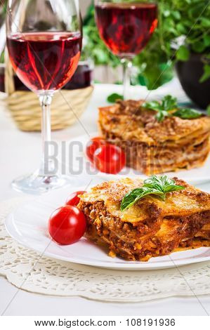 Piece Of Tasty Hot Lasagna With Red Wine..
