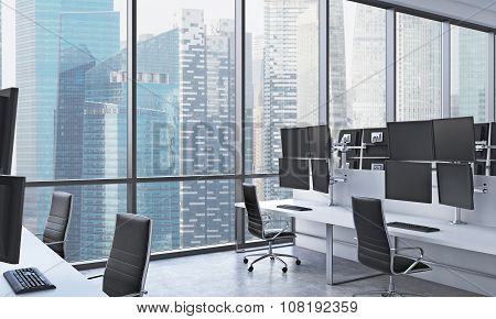 A Modern Trader's Workplaces In A Bright Modern Open Space Office. White Tables Equipped With Modern