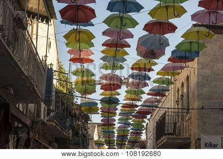 Jerusalem, Israel - September 26, 2015 : Hanging Multicoloured umbrellas over blue sky Colourful umb