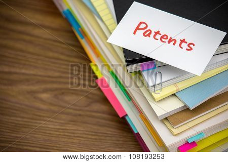 Patents; The Pile Of Business Documents On The Desk