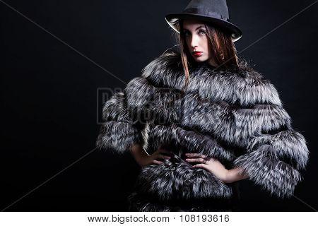 Fashion woman in fur coat