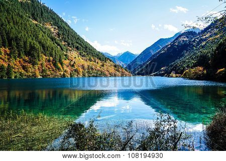 Scenery Of Lake in Forest with Colorful Leafs and Mountain in Autumn