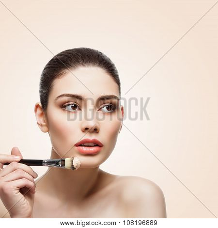 Girl putting on foundation