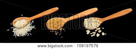 Rice, Mustard Seeds And Oat Flakes In Wooden Spoons On Black Background