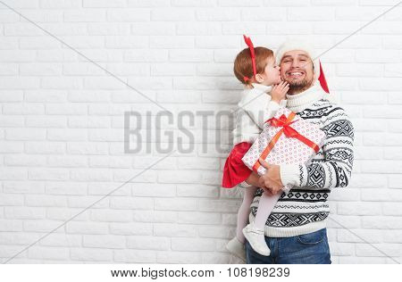 Happy Family Father And Child With Gift In Christmas Kiss