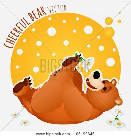 Carefree bear lies and plays with flower