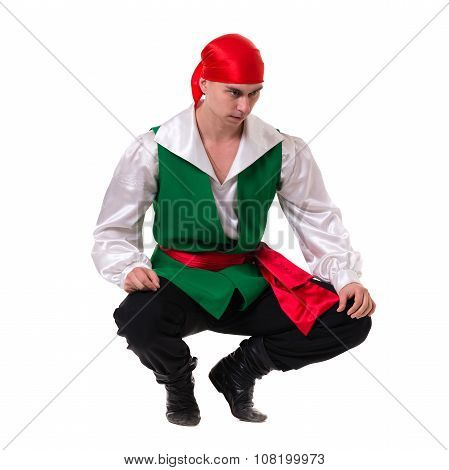 Dancing man wearing a pirate costume. Isolated on white in full length.