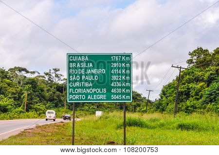 Road Sign In The Amazon Rainforest, Brazil
