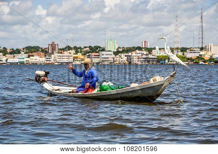 Local Fisherman On The Amazon River, Brazil
