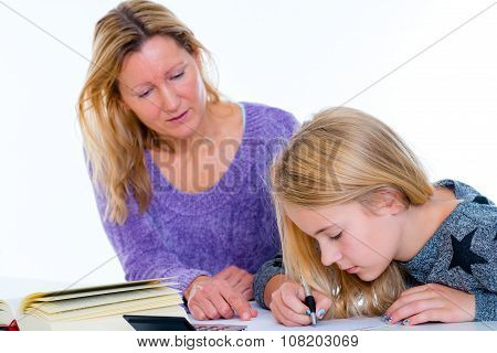 Girl And Together With Teacher In The Classroom