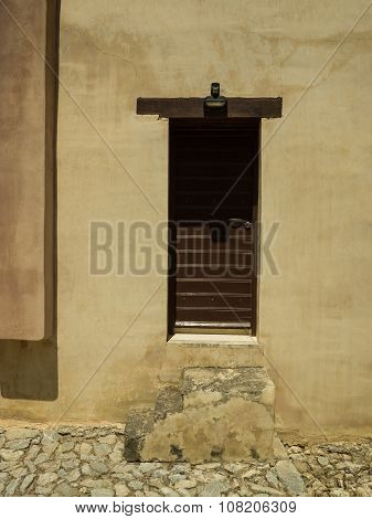 Stone Steps And Brown Door