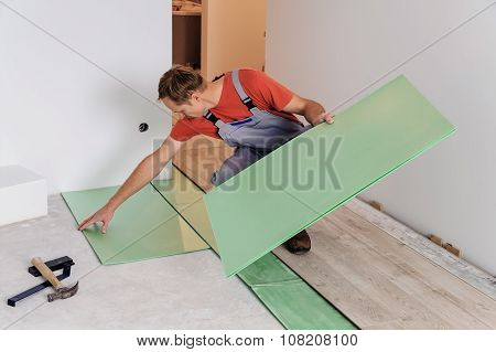 Worker Puts The Pieces Underlaymen