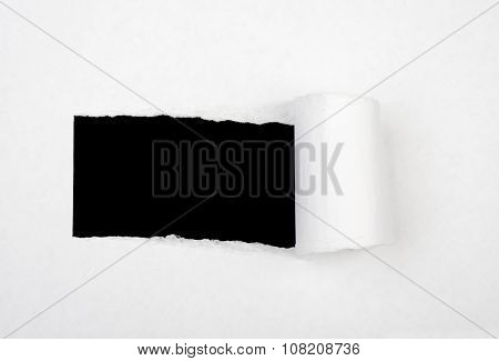 Hole in white sheet of paper