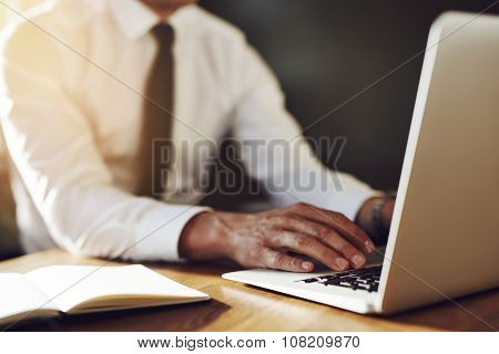 Close Up Of Hands Writing At Laptop, Business Concept