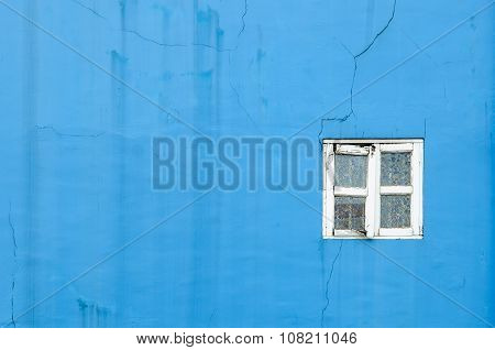 blue crack and broken stucco wall texture with vintage broken white window background