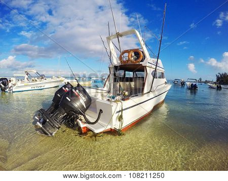 FLIC EN FLAC, MAURITIUS ISLAND - NOVEMBER 2, 2015: The Vagabond 3 big game fishing boat with two Suzuki four stroke engines in Flic En Flac Marine.