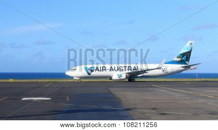 SAINT DENIS, REUNION ISLAND, FRANCE - NOVEMBER 9, 2015: The Boeing 737-300 Air Austral ready for flight on Roland Garros Airport near Indian Ocean coast. Modern aircraft for 128 passengers.